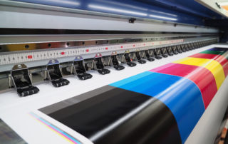 Close-Up-Of-Wide-Format-Printer-Showing-CMYK