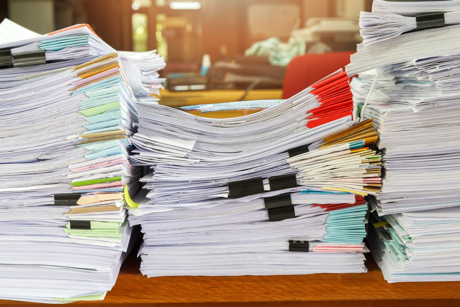 a-stack-of-documents-that-show-the-business-benefits-of-managed-print-services