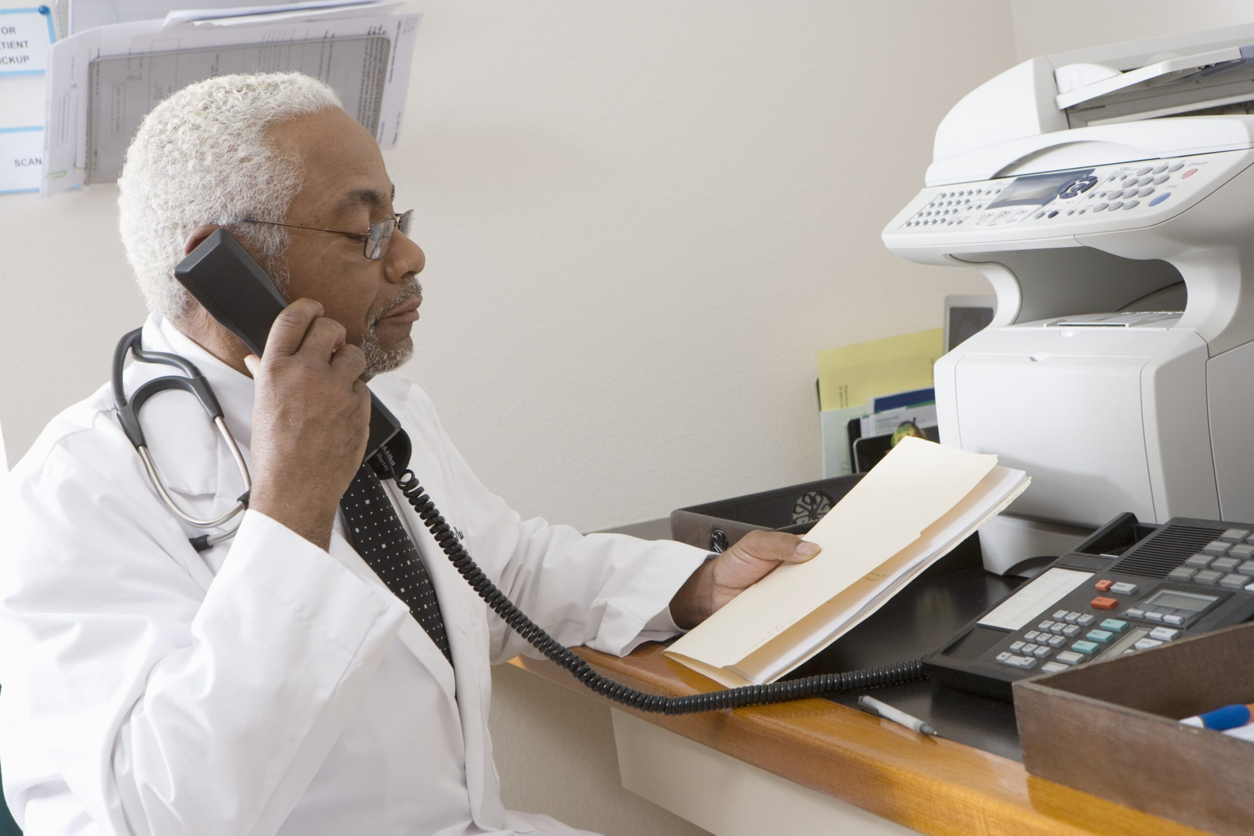 doctor on phone with papers